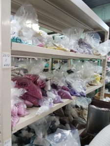 finished bags and containers of beads in the packing room